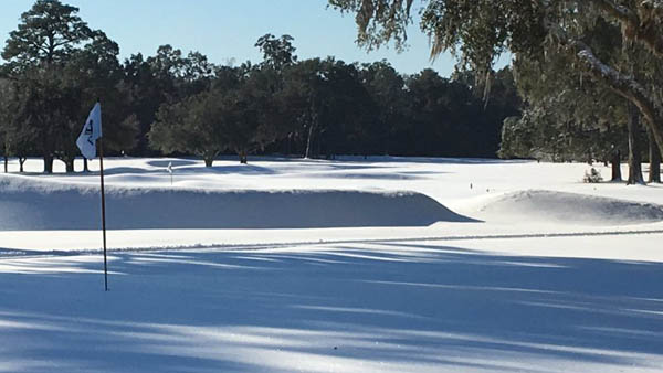 Snow, cold temperatures sock in golf courses north and south