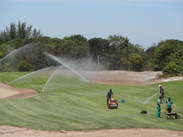 Crews work on the fifth hole at the Olympic Golf Course in Rio de Janeiro.