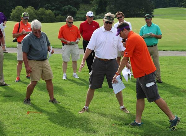 Clemson's guide for professional turfgrass managers is like having Bert McCarty (wearing the visor in center) and Bruce Martin at your disposal 24 hours a day.