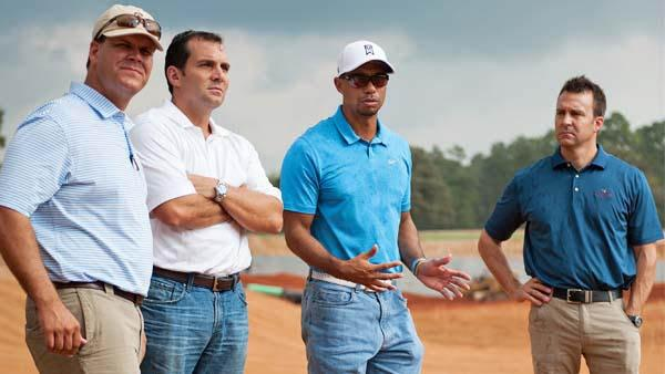 Tiger Woods discusses plans for his Bluejack National design in Texas with superintendent Eric Bauer, Andy Mitchell, president of Lantern Asset Management, and Brandon Goodyk, director of development (left to right). The Houston-area course opened in 2016 and was the first designed by Woods. Plans for another Woods-designed course in North Carolina have been suspended.