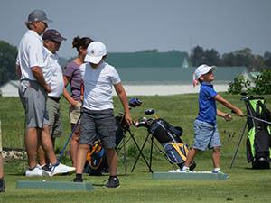 John Cook, left, and his family have been backers of junior golf for many years.