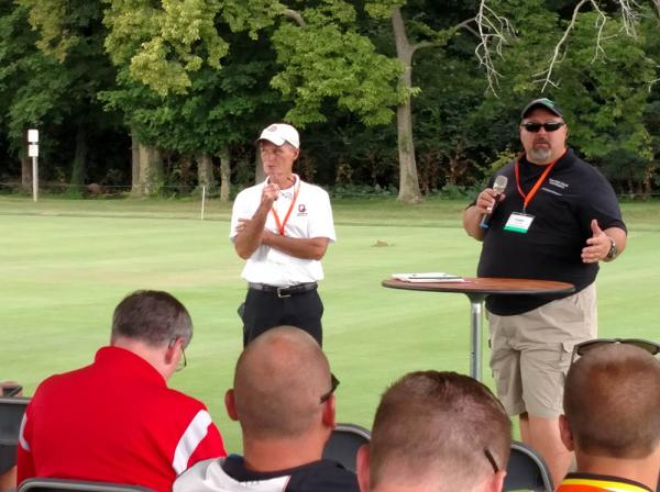 Joe Rimelspach, Ph.D., (left) and Todd Hicks address attendees at this year's OTF field day.