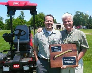 2012 Technician of the Year winner Kevin Bauer, left, and his father, Don. Pictured on the front page is 2013 winner Brian Sjogren.