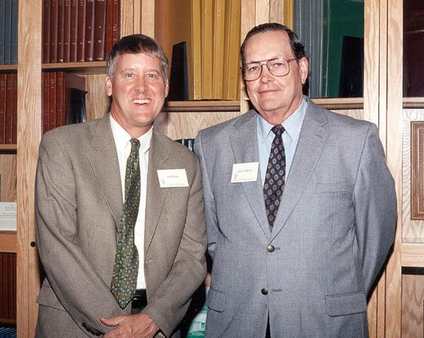 Michigan State director of libraries Clifford Haka (left) and James Beard, Ph.D. at the dedication of the James B. Beard Turfgrass Library Collection in 2003.