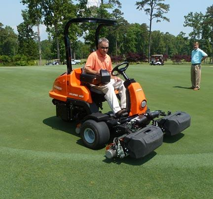 Paul Carter demonstrates the Jacobsen Eclipse 322 electric mower while Jeff Hollister of Chattanooga Golf and Country Club looks on.