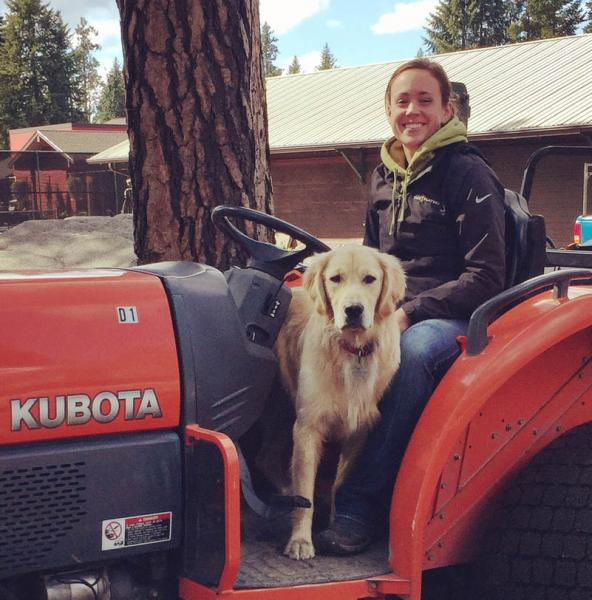 Jessica Lenihan and her dog Kevin hard at work at Hayden Lake Country Club.