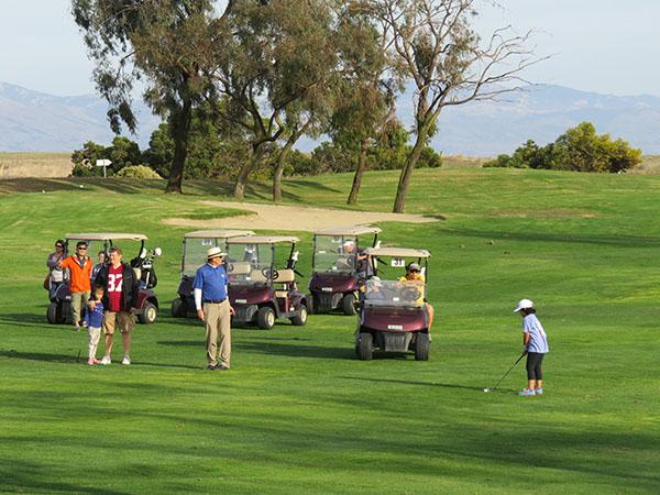 Women's Golf Day was developed to provide girls and women with lessons and an inviting environment in which to learn the game of golf. Photo by John Reitman