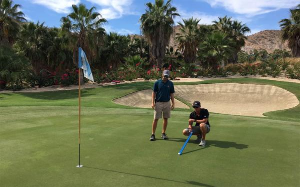 Brian Conlon, left, and Mitch Peterson take a Stimpmeter reading on one of El Dorado's lightning quick greens.