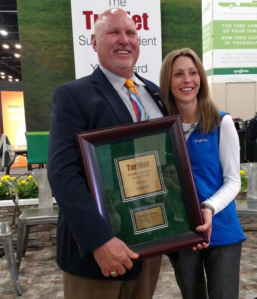 Stephanie Schwenke, turf market manager for Syngenta, presents Rick Tegtmeier, CGCS, with the Superintendent of the Year Award.