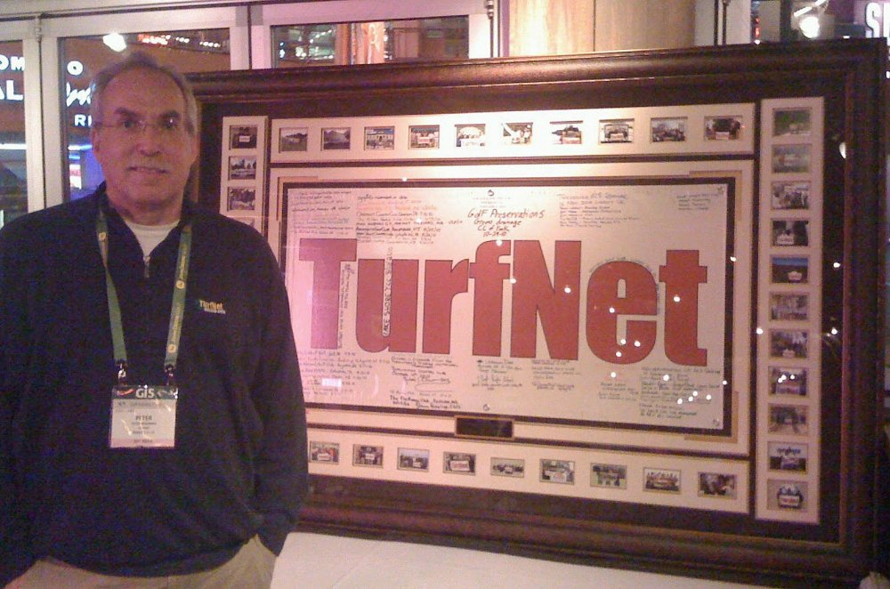 TurfNet founder Peter McCormick with the 'Where's TurfNet?' banner at the 2011 GIS in Orlando.