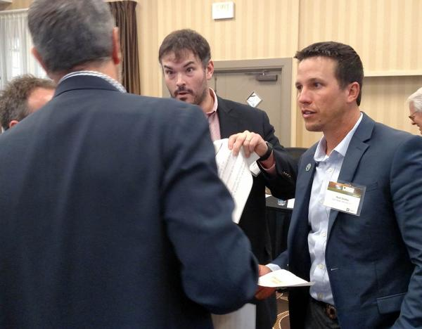 David Groelle, left, listens while John Heywood, center, and Ryan Swilley emphatically make their point during an SBI exercise.