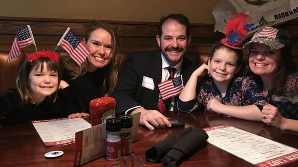 Pat O'Brien, center, celebrates his U.S. citizenship with, from left, daughter Maeve, sister-in-law Suzy Henke, daughter Brynna and wife Jen.