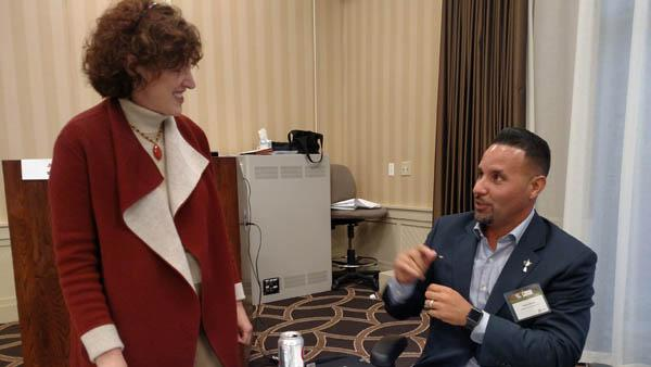 Amy Wallis, Ph.D., of Wake Forest and Carlos Arraya of Bellerive Country Club discuss managing across generations. Photos by John Reitman
