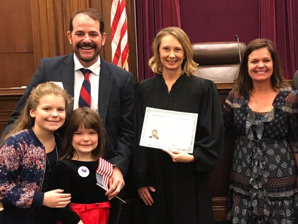 O'Brien and his family with U.S. Magistrate Judge Sandra K. Bowman, center.