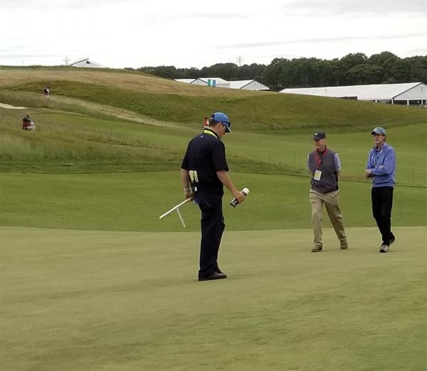 Shinnecock Hills superintendent Jon Jennings (center) and Brad Klein of the Golf Channel walk the course before Friday's second round. Photo by Anthony Minniti via Twitter (@aminniti147)