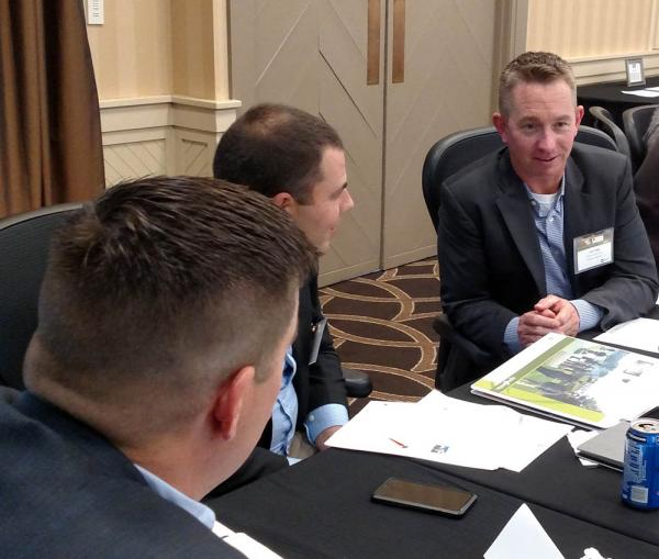 Josh Pope, right, works on a group project at this year's Syngenta Business Institute.