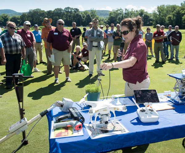 Michelle DaCosta, Ph.D., keeps the crowd's attention at a recent UMass field day.