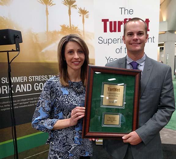 Stephanie Schwenke of Syngenta presents the 2015 TurfNet Superintendent of the Year Award to Matt Gourlay, CGCS of Colbert Hills in Manhattan, Kansas.